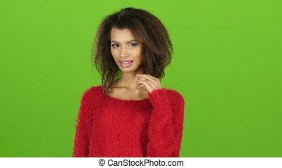 Mulatto girl flirting and posing on camera, green screen...