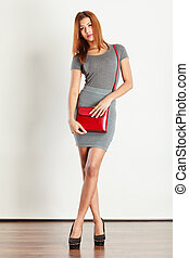 Mulatto girl gray wear with red handbag