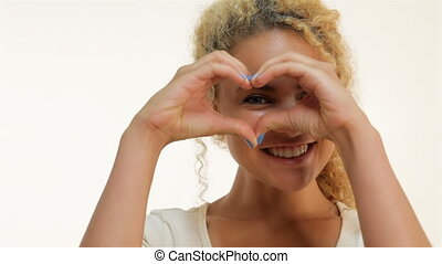 Mulatto woman showing heart shape gesture