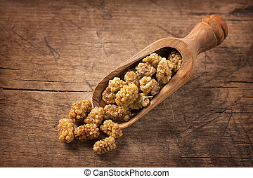 Mulberries in a spoon