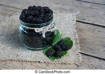 Mulberry berries in a jar