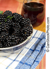 mulberry on table with a juice