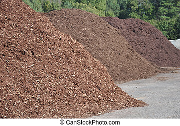 Mulch - three different types of mulch offered for sale at a...
