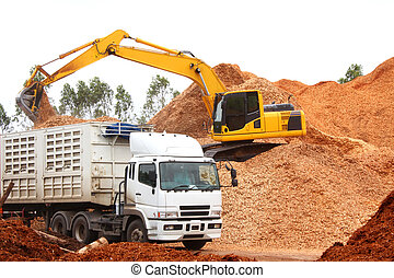 Mulch Wood Pieces for make wood pulp with backhoe loader and...