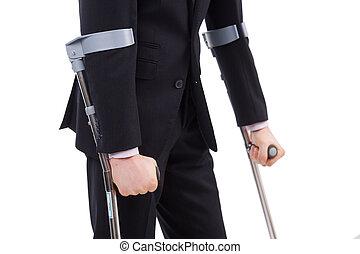 muletas, hombre de negocios, tenencia, traje