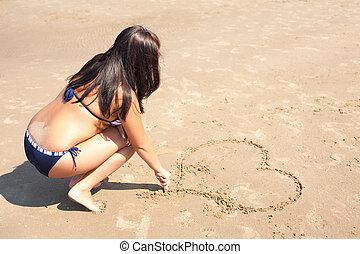 mulher, é, drowing, um, coração, areia