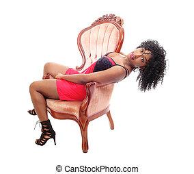 mulher americana africana, sentando, em, armchair.