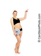 mulher aponta, copyspace, atlético, jovem, tábua, segurando, equilíbrio, ou, algo