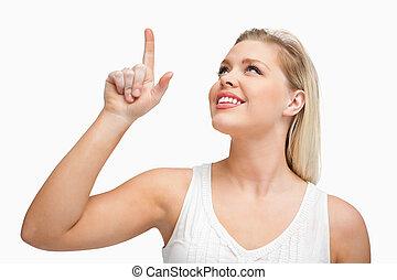 mulher aponta, dela, cima, atraente, loiro, dedo