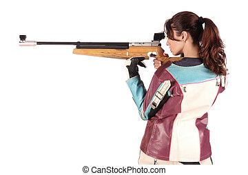 mulher, apontar, um, pneumático, ar, rifle