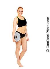 mulher, atlético, jovem, tábua, segurando, equilíbrio