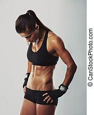 mulher, bodybuilder, descansar, após, malhação