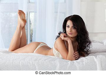 mulher bonita, cama