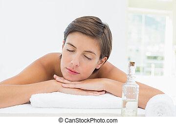 mulher bonita, cima, jovem, fim, tabela, massagem