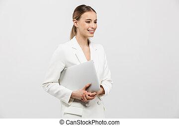 mulher bonita, computer., parede, sobre, fundo, isolado, espantoso, posar, segurando, branca, laptop