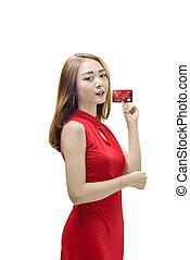 mulher bonita, dela, chinês, mostrando, tradicional, crédito, mãos, vestido, cartão