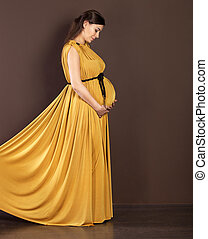 mulher bonita, grávida, longo, vestido, feliz