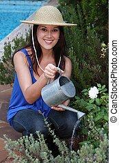 mulher bonita, jardineiro