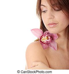 mulher bonita, jovem, orquídea