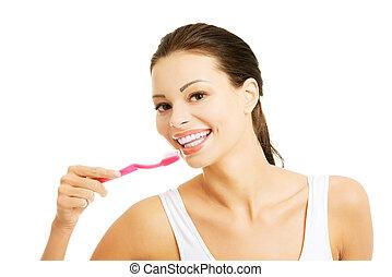mulher bonita, lavando, dela, jovem, dentes