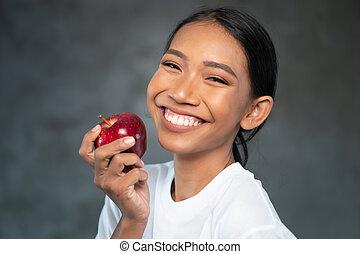 mulher bonita, maçã, jovem, retrato, sorrindo, vermelho