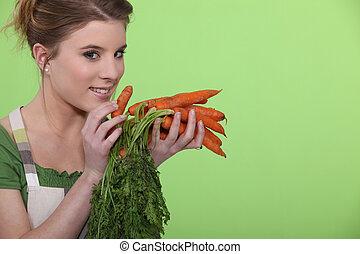 mulher, cenouras, segurando, grupo