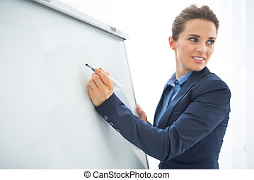 mulher, closeup, flipchart, negócio, escrita