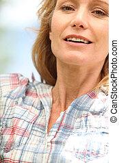 mulher closeup, thirties, dela