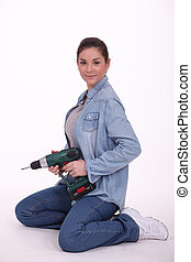 mulher, com, broca elétrica