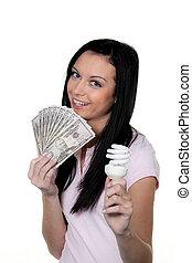 mulher, com, energy-saving, lamp., lâmpada, energia, e,...