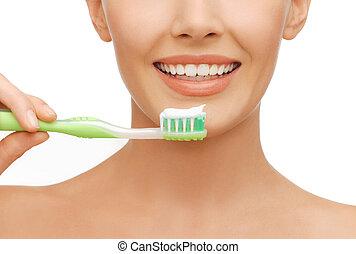 mulher, com, escova de dentes