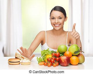 mulher, com, frutas, rejeitar, comida vulgar