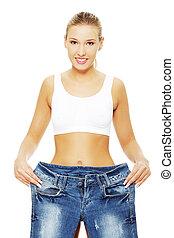 mulher, com, igualmente, grande, calças brim