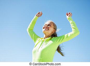 mulher, corredor, celebrando, vitória