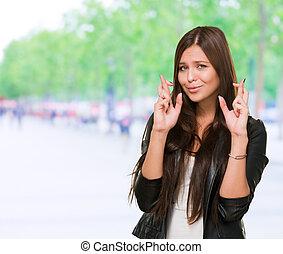 mulher, cruzado, jovem, dedos