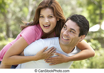 mulher, dar, jovem, piggyback, ao ar livre, homem
