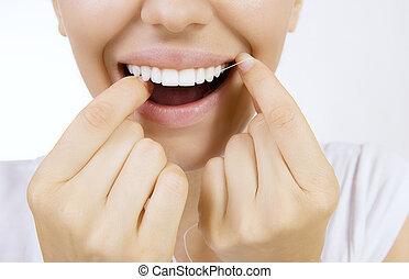 mulher, dentes, floss