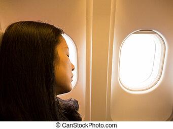 mulher, dormir, seu, enquanto, viajando, assentos, avião