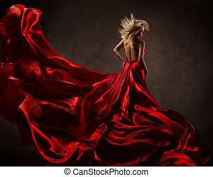 mulher, em, vermelho, waving, vestido, com, voando, fabric., costas, vista lateral