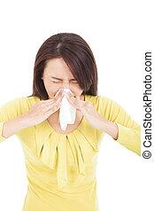 mulher, espirrando, jovem, nariz, gelado, tendo