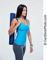 mulher, esteira yoga, segurando, condicão física
