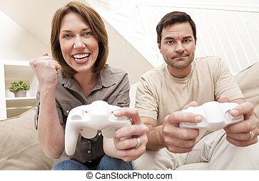 mulher homem, par, tocando, vídeo, console, jogo