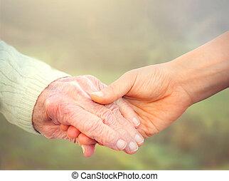 mulher idosa, segurar passa, com, jovem, caregiver
