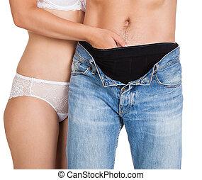 mulher, inserindo, dela, mãos, em, homem, calças brim