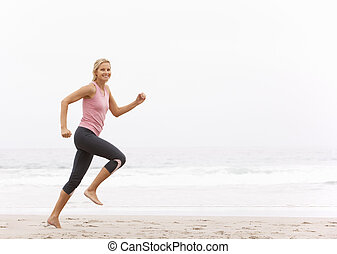 mulher, inverno, jovem, funcionar ao longo praia