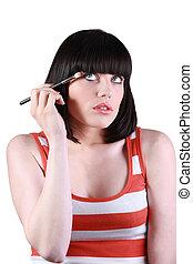 mulher jovem, aplicando, eye sombra