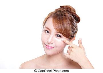 mulher jovem, aplicando, moisturizer, creme, ligado, rosto