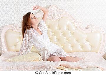 mulher, jovem, cama, sentando