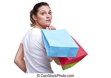 mulher jovem, carregar, bolsas para compras