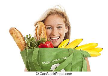 mulher jovem, com, alimento saudável